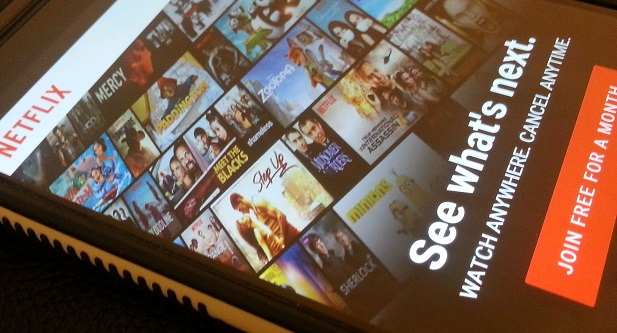 FILE - Home screen of the Netflix app is displayed on a mobile device in this November 30, 2016 file photo. (Jake West)